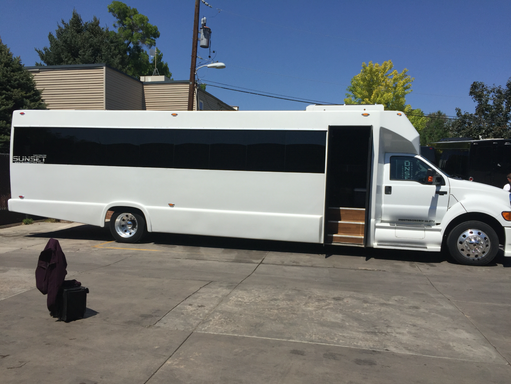 Sunset Transportation 39 Passenger White Luxury Coach Exterior