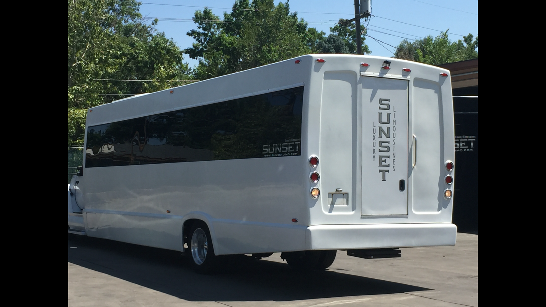 sunset transportation 39 passenger white luxury coach