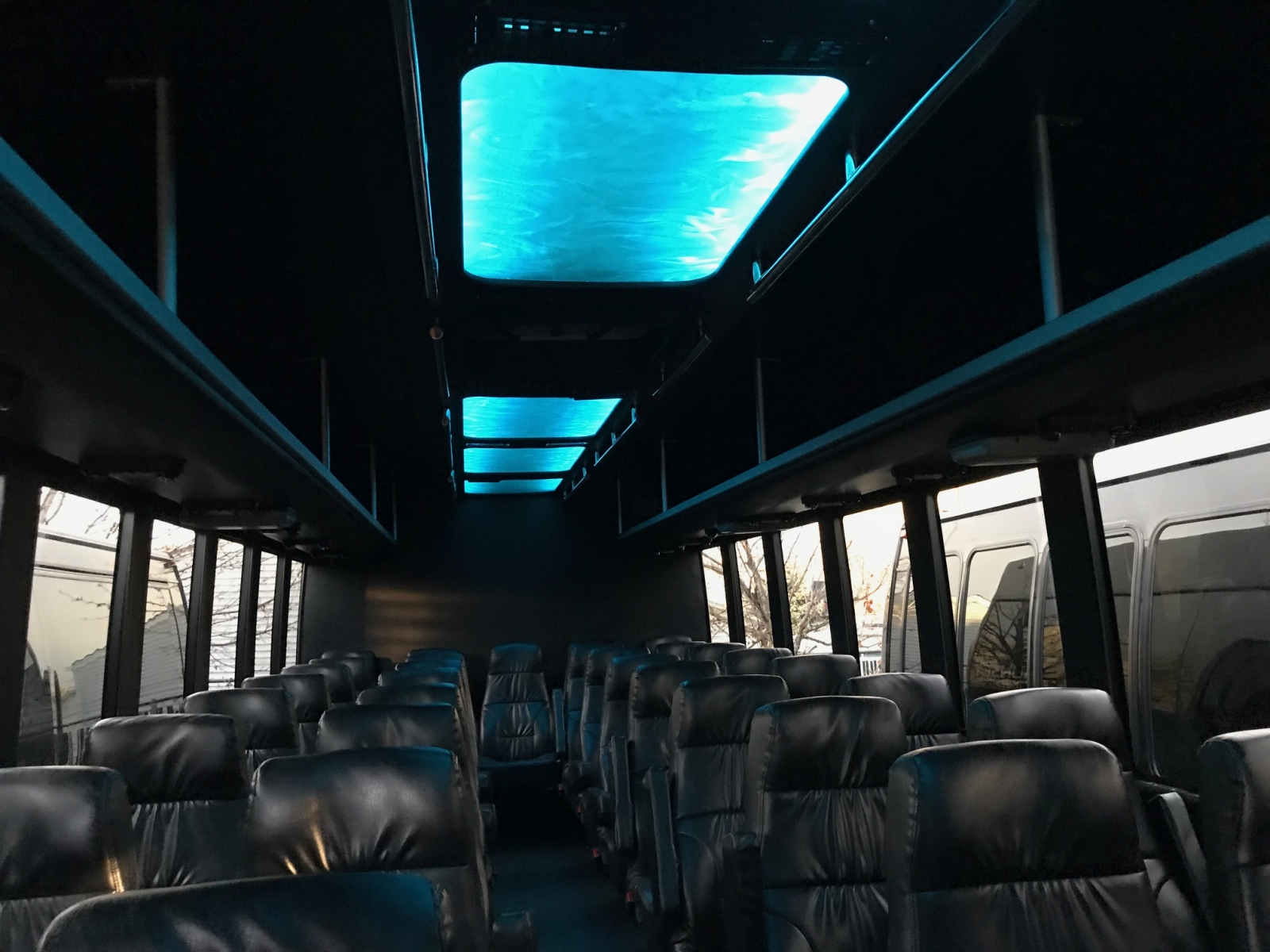 Sunset Transportation 37 Passenger Black Luxury Coach Lighting