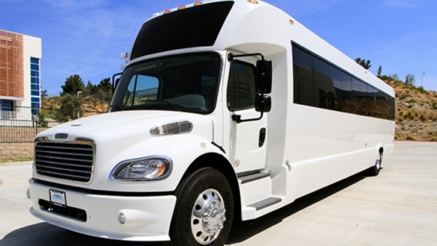 sunset transportation 51 passenger white luxury coach